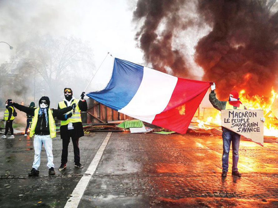 Protesters+wave+a+french+flag