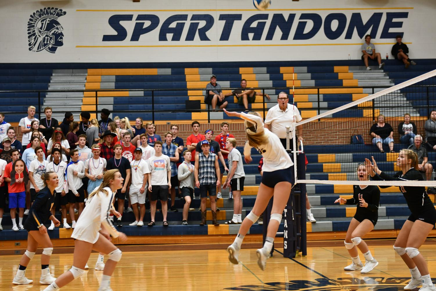 Junior Brooke Swanson goes up for a kill against Red River Tuesday night.