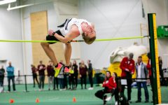 Enerson flipping over the bar in the high jump