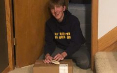 Schultze receiving a package during his Covid quarantine.